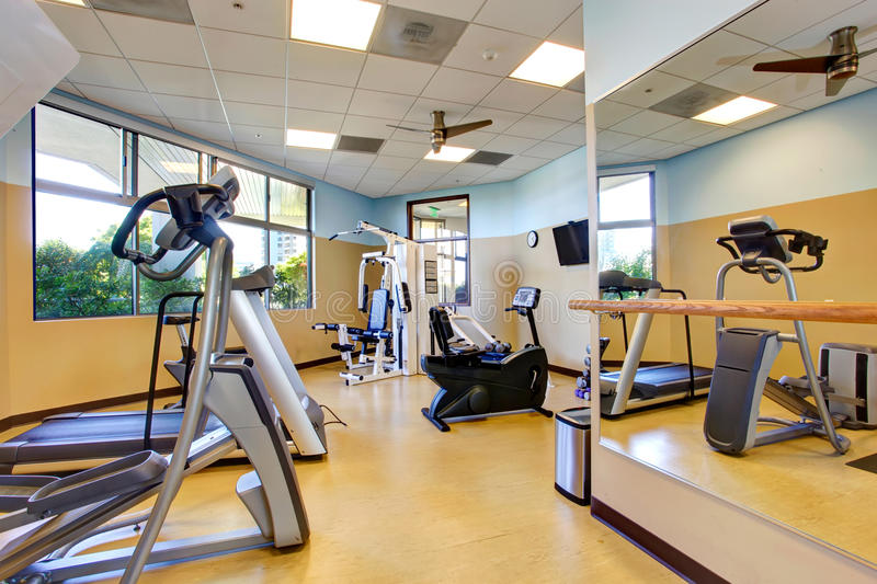 Bright gym room in residential building stock image