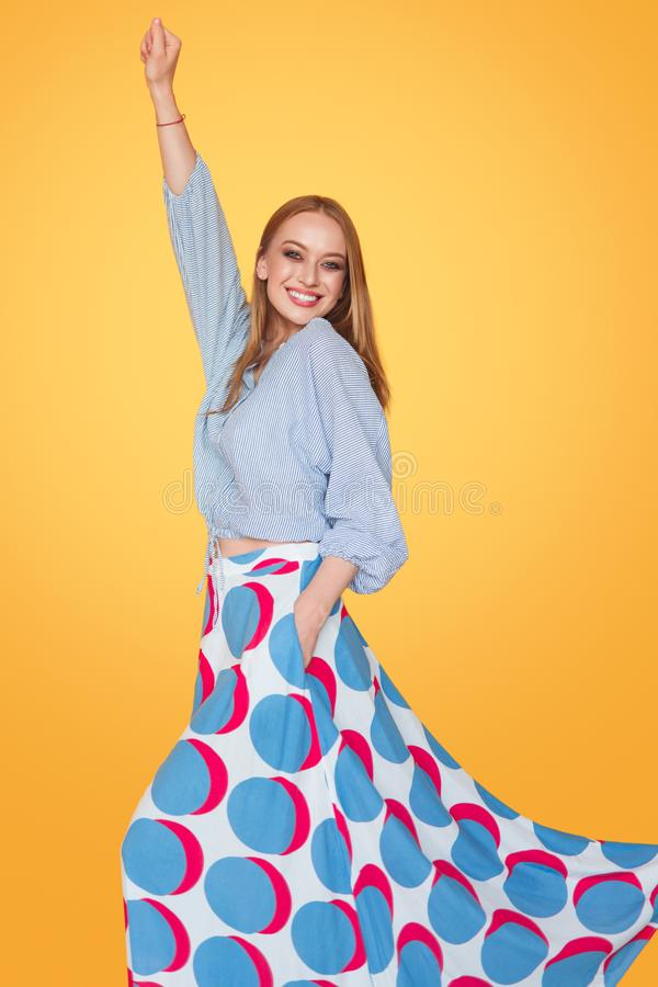 Bright happy woman in colorful outfit stock images