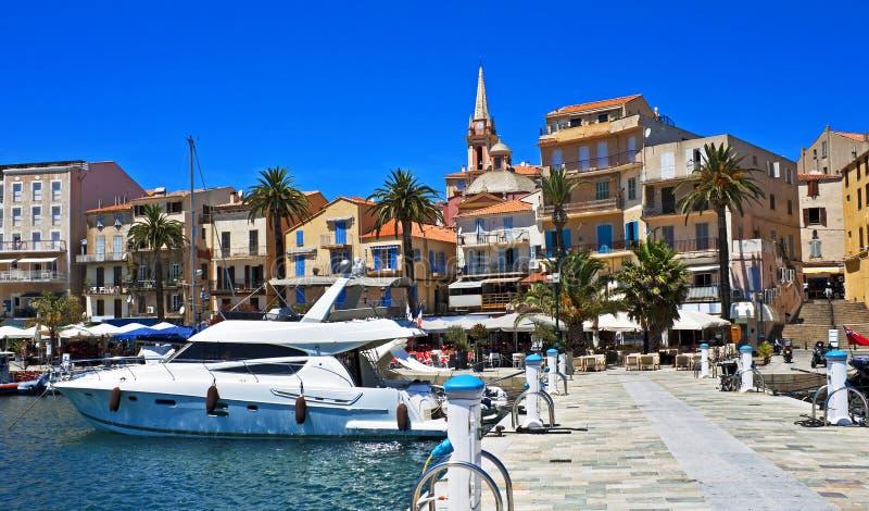 Bright harbor, Calvi, Corsica. Pretty harbor with boats, cafes, and walkways, Calvi, Corsica, France royalty free stock image