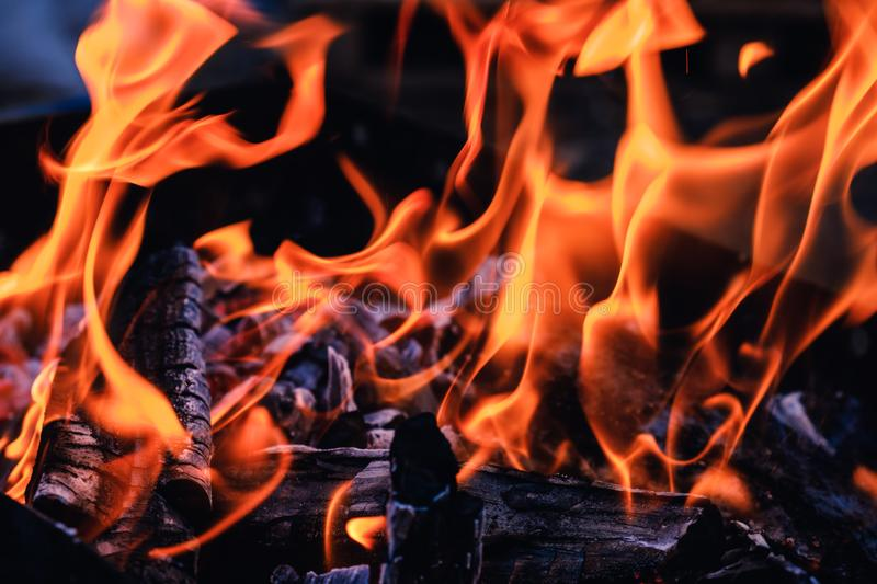 Bright hot coals and burning woods in bbq grill pit. Glowing and flaming charcoal, barbecue, red fire and ash. Weekend recreation background. Close-up, top stock photos