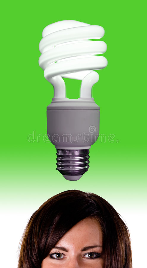 Bright Idea 2. Vertical image of a compact fluorescent light bulb over a model's head stock image
