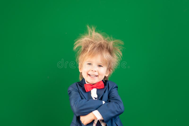 Bright idea! Happy child student against green chalkboard stock images