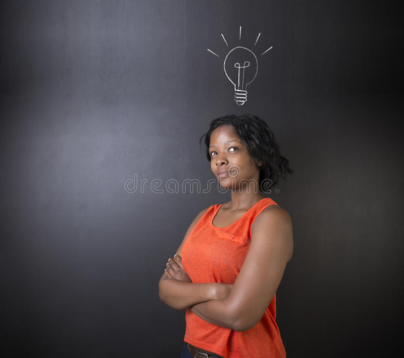 Bright idea lightbulb thinking South African or African American woman teacher or student royalty free stock photos