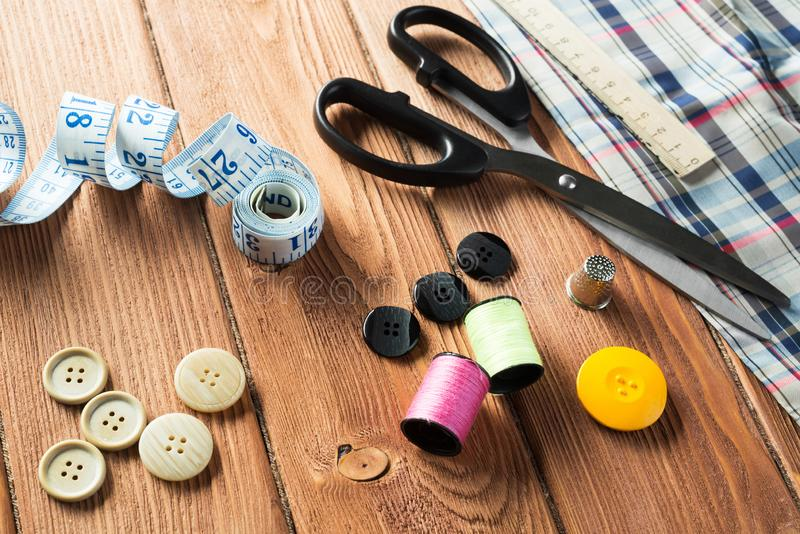 Items for sewing or DIY. Bright image of sewing kit accessories on wooden table royalty free stock photos