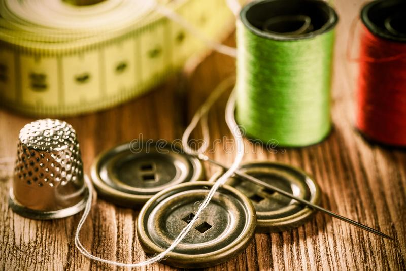 Items for sewing or DIY. Bright image of sewing kit accessories on wooden table royalty free stock photo