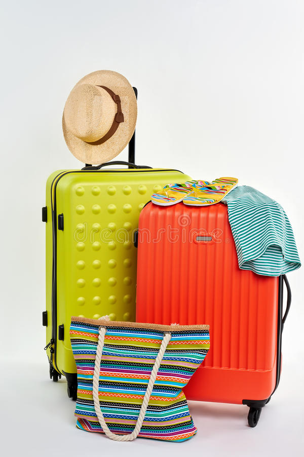 Bright image of summer accessories. Suitcases for family rest abroad royalty free stock photo