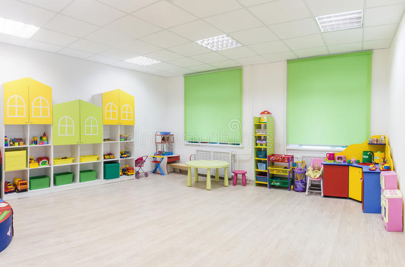Bright Interior of a modern kindergarten in yellow and green colors. Panoramic view. Light interior of a modern kindergarten in yellow and green colors royalty free stock photography