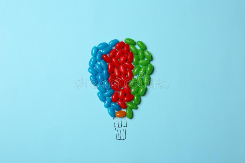 Bright jelly candies arranged as air balloon, flat lay. Bright jelly candies arranged as air balloon on color background, flat lay stock photo