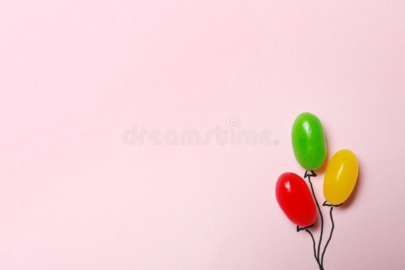 Bright jelly candies arranged as balloons, flat lay. Space for text. Bright jelly candies arranged as balloons on color background, flat lay. Space for text royalty free stock photography