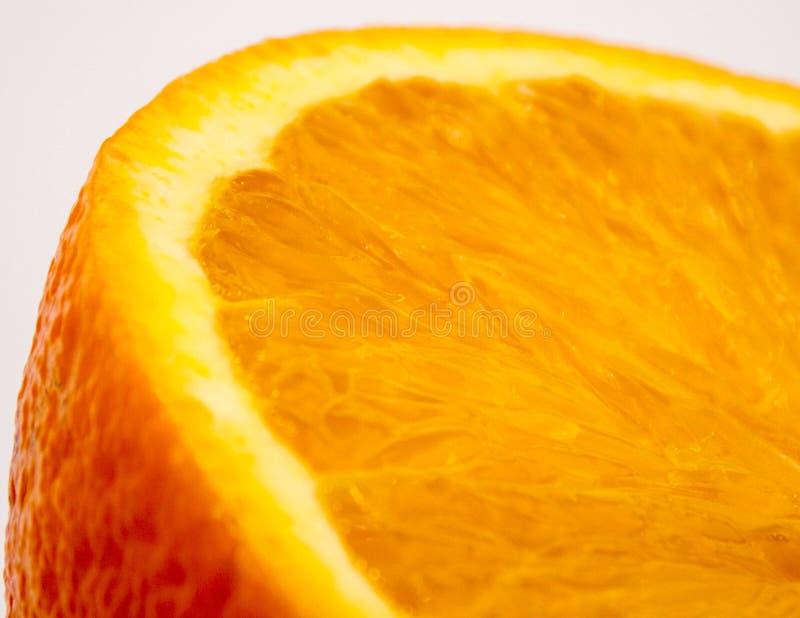 Bright juicy orange sectional macro photo stock photo