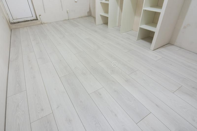 Bright laminate is laid in renovated residential building. Bright laminate is laid in a renovated residential building stock image