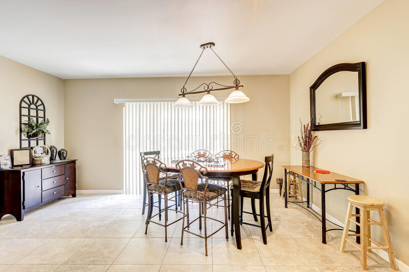 Download Bright And Light Dining Room With Bar Style Chairs Tile Floor Stock Image