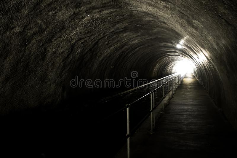 Bright Light At The End Of A Dark And Creepy Tunnel.  royalty free stock photo