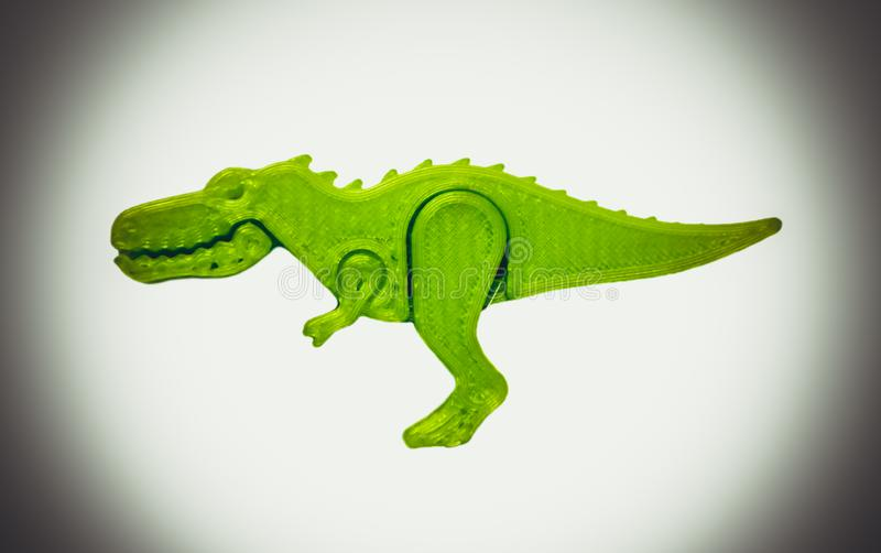 Bright light green object in shape of dinosaur toy printed on 3d printer. Isolated on white background. Fused deposition modeling, FDM. Concept modern stock image