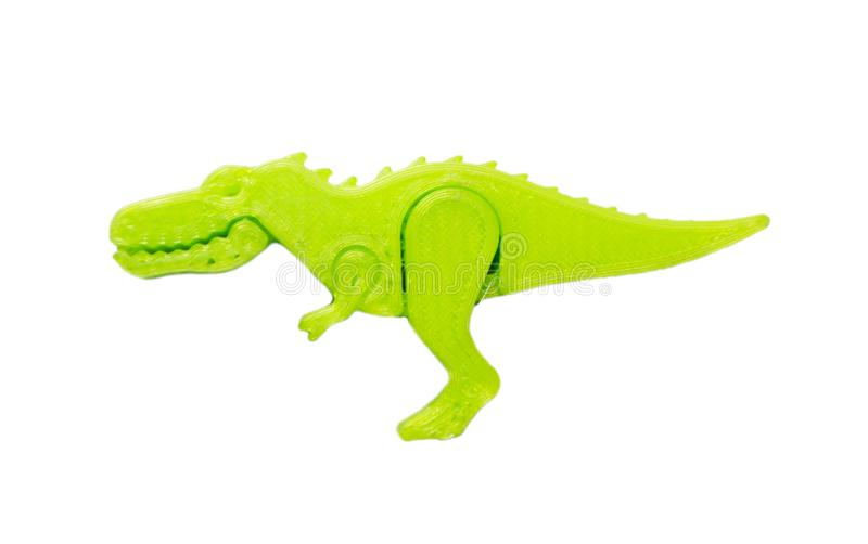 Bright light green object in shape of dinosaur toy printed on 3d printer. Isolated on white background. Fused deposition modeling, FDM. Concept modern stock photo