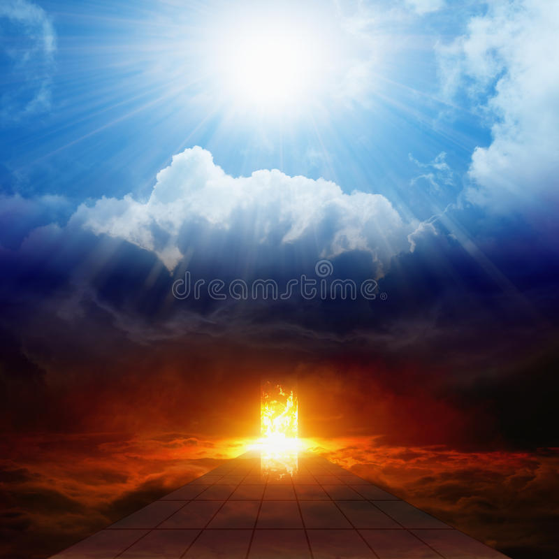 Bright light from heaven, road to hell, heaven and hell. Dramatic religious background - bright light from heaven, burning doorway in dark red sky, road to hell royalty free stock image