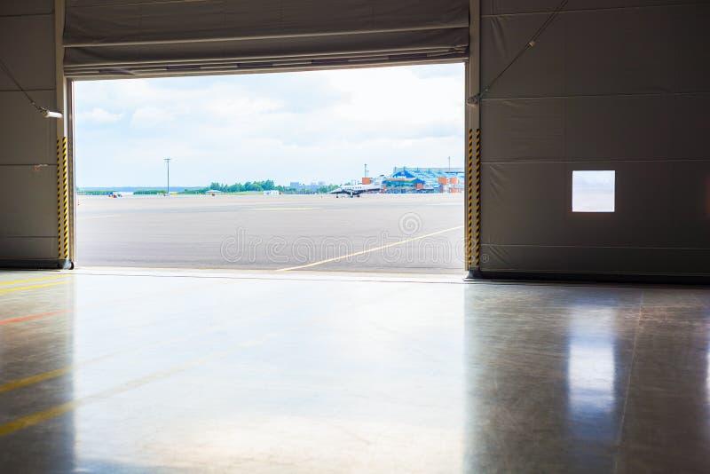 Bright light in open hangar doors royalty free stock photography