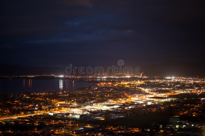 Bright light of Rotorua city at night royalty free stock images