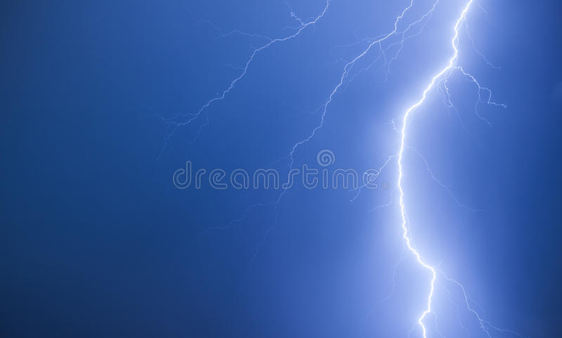 Bright lightning on a dark blue night sky. Natural background photo royalty free stock photos