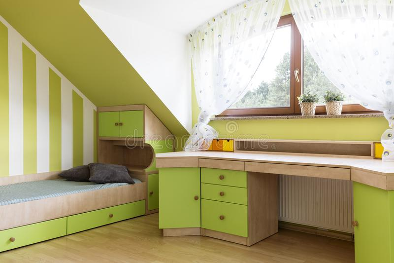 Bright lime room for teenager at the attic royalty free stock photos
