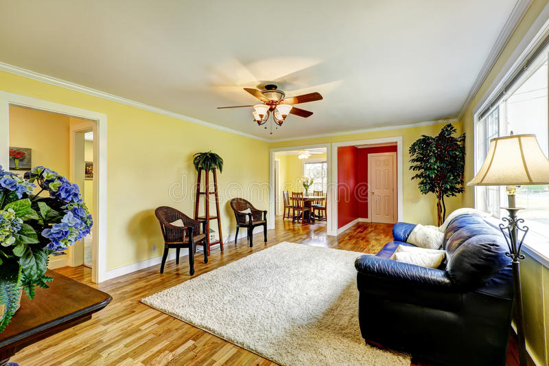 Bright Living Room With Yellow And Red Walls Stock Image - Image of ...