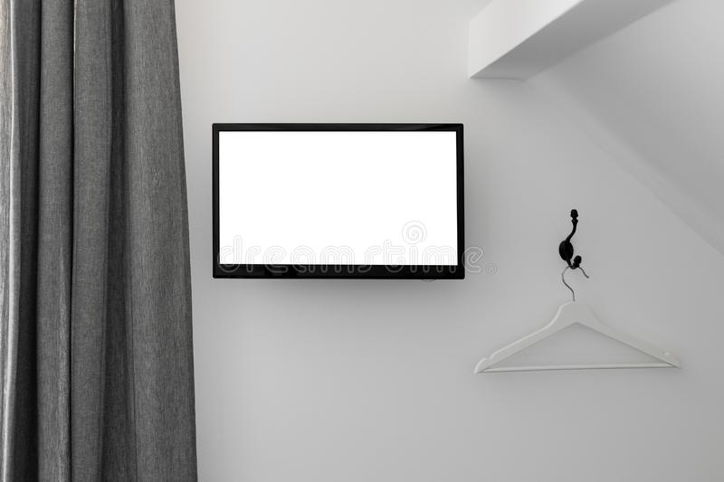 Bright loft bedroom interior with tv on the wall stock photos