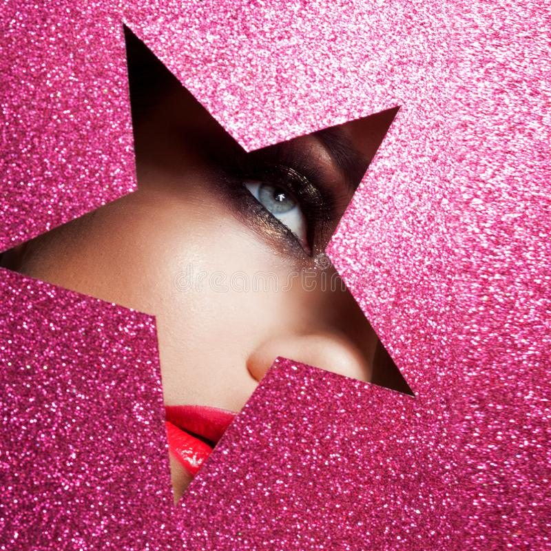 Bright makeup and you`re a star. Beautiful girl close up, paper in the shape of a star. royalty free stock images