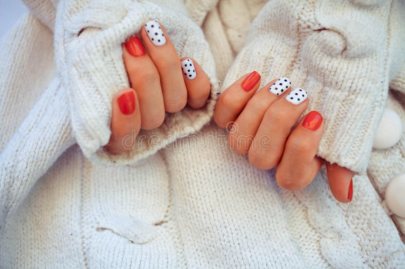 Bright manicure on a knitted background royalty free stock photos