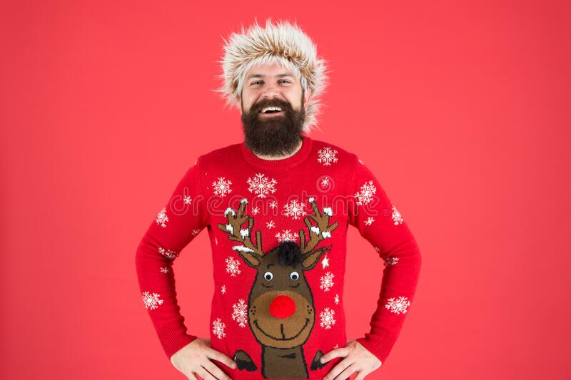 Bright memories. happy new 2020 year. bearded man on red background. funny man with beard in knitted sweater. smiling stock photos