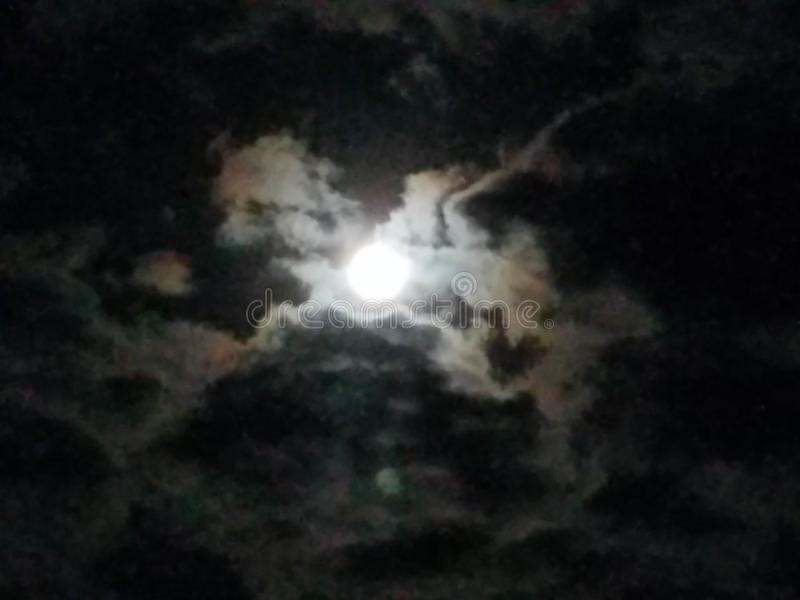 Bright Moon Cloudy Sky royalty free stock image