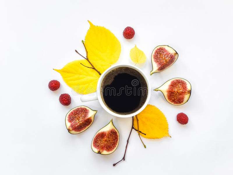 Bright morning cup of coffee with fig fruits and raspberries. Autumn decoration. Flat lay, top view stock images
