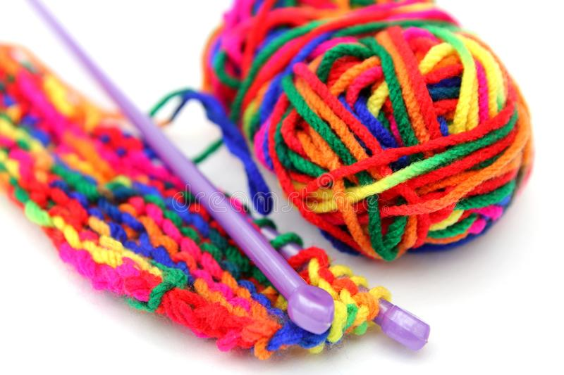 Bright multi-colored colourful knitting wool or yarn with knitting needles on white background stock photo