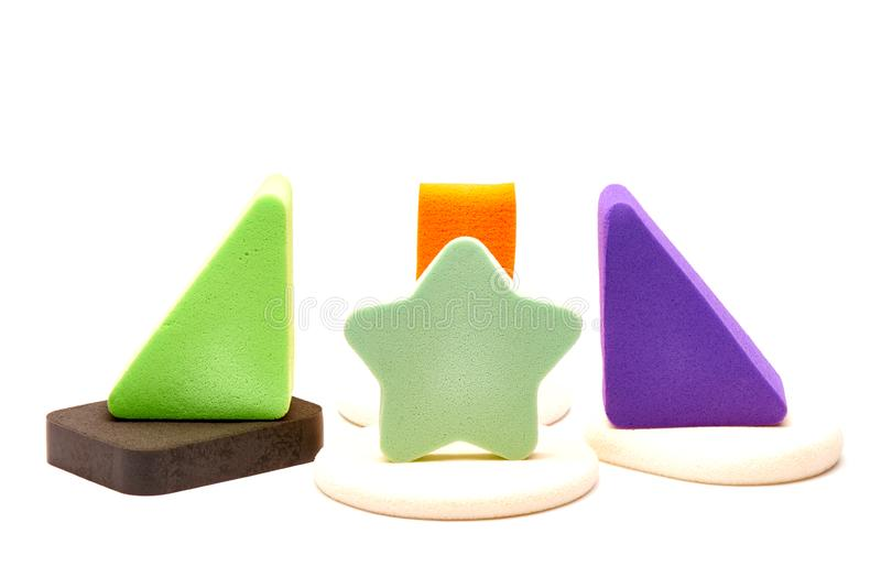Bright multi-colored cosmetic sponges on a white background stock photos