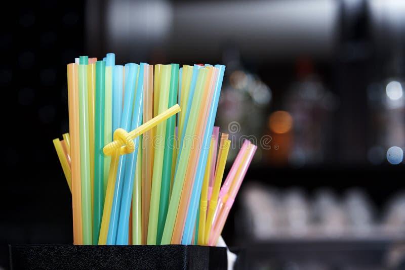 Bright multi colored straws stock photos