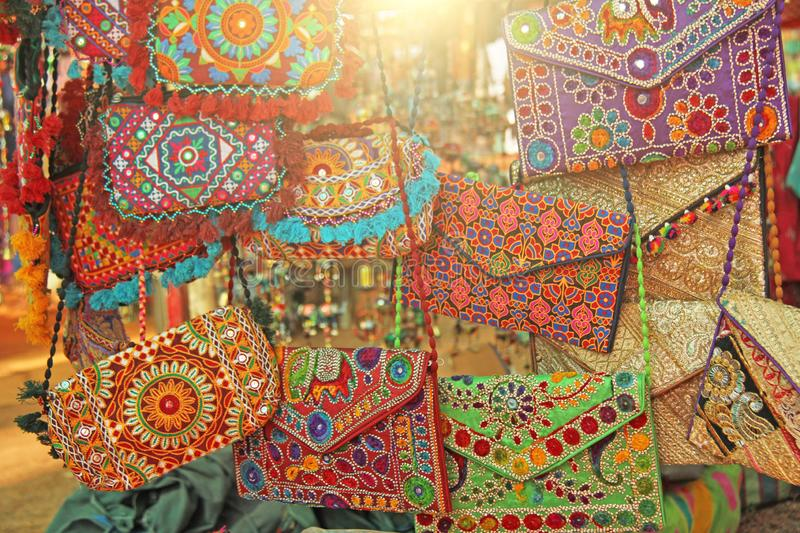 Bright national colored handbags are handmade embroidery cosmetic products sold on the market in India. Gift souvenir India Tibet. Bazaar stock photo