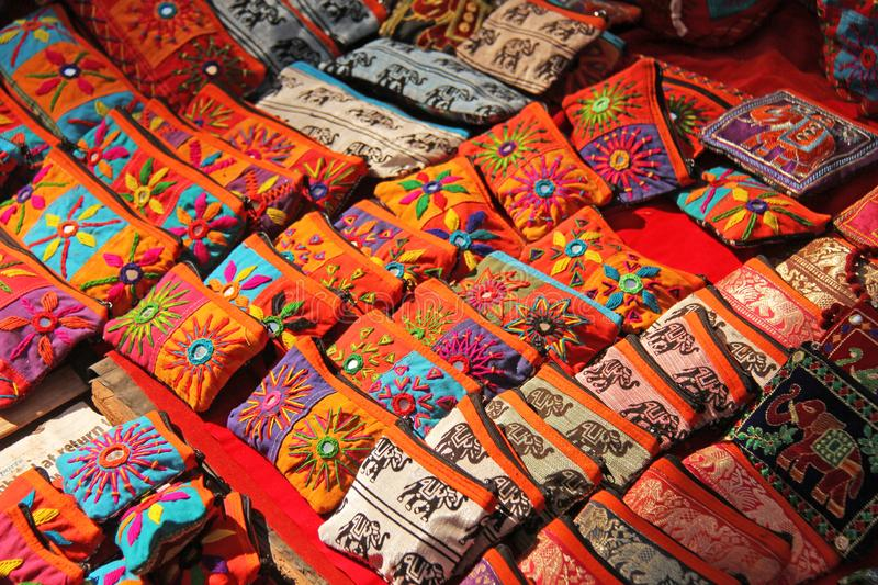 Bright national colored handbags are handmade embroidery cosmetic products sold on the market in India. Gift souvenir India Tibet. Bazaar stock photography