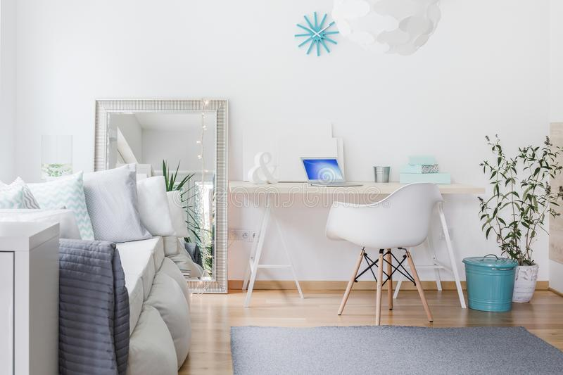 Bright nook with desk. In living room stock photo