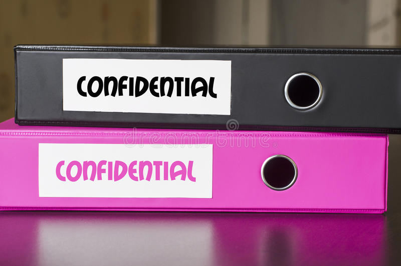 Bright office folders and confidential text concept royalty free stock image