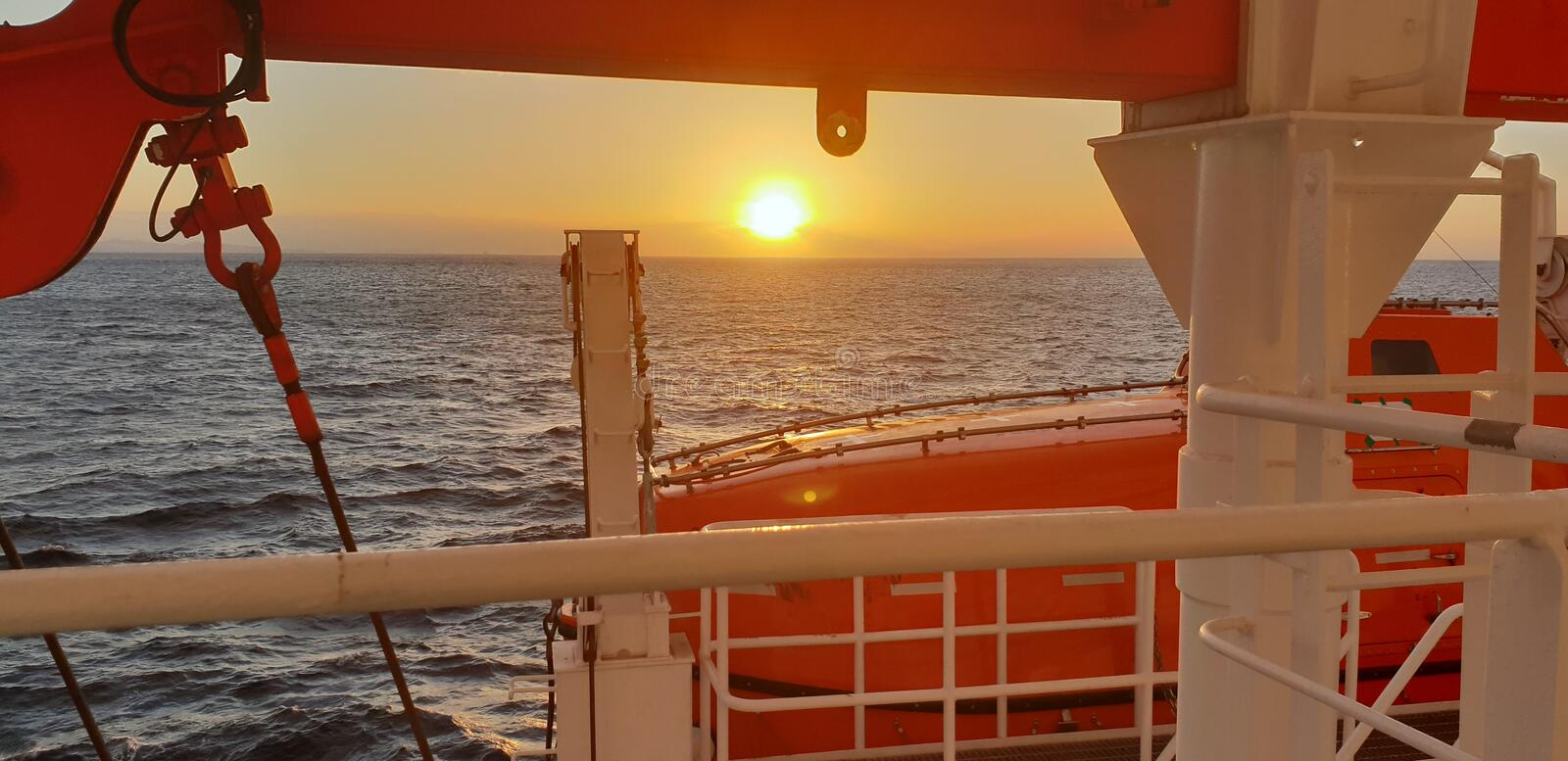 Marine sunrise, be safe. Safety first! royalty free stock images