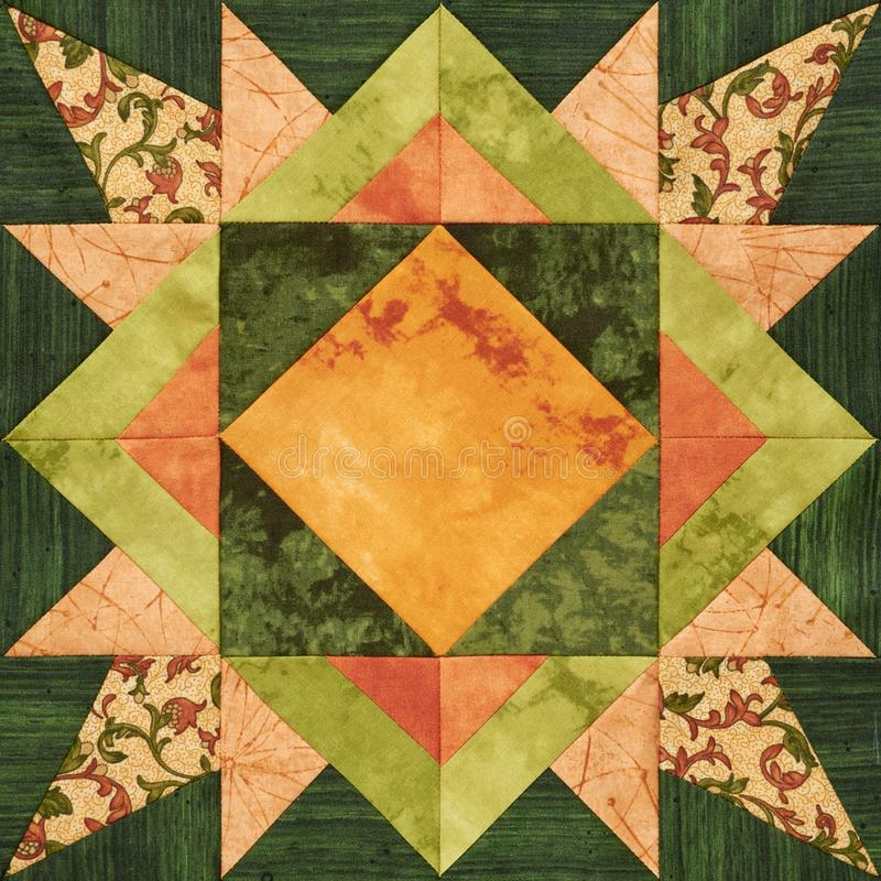 Bright orange-green geometric patchwork block from pieces of fabrics stock illustration