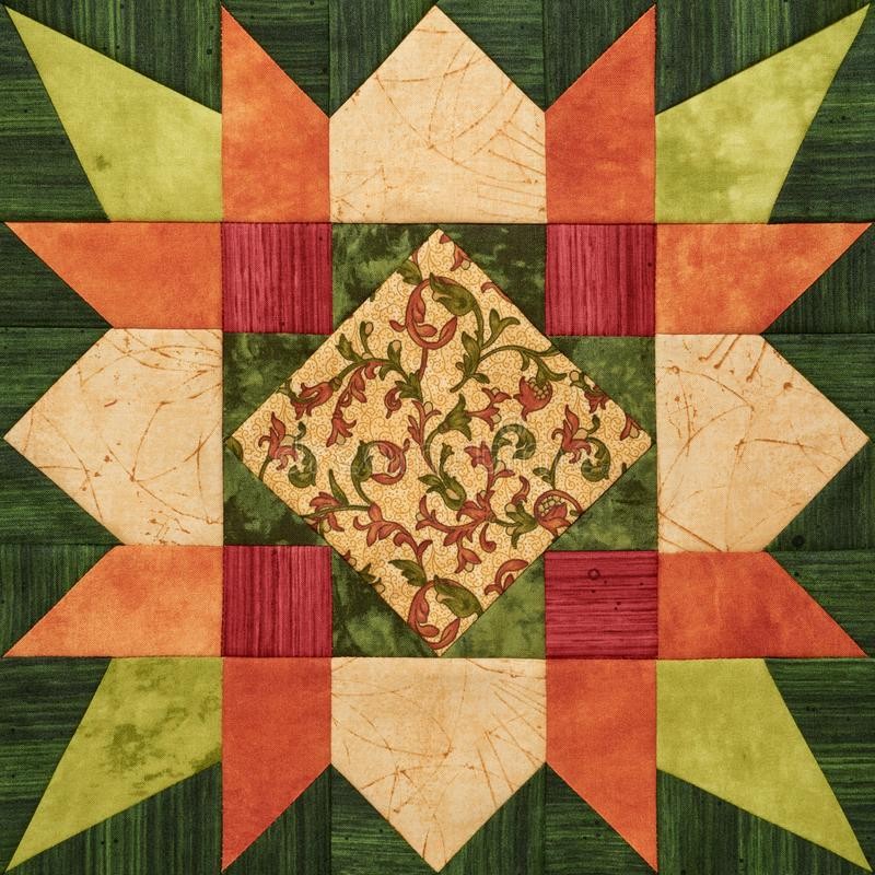 Bright orange-green geometric patchwork block from pieces of fab stock photos