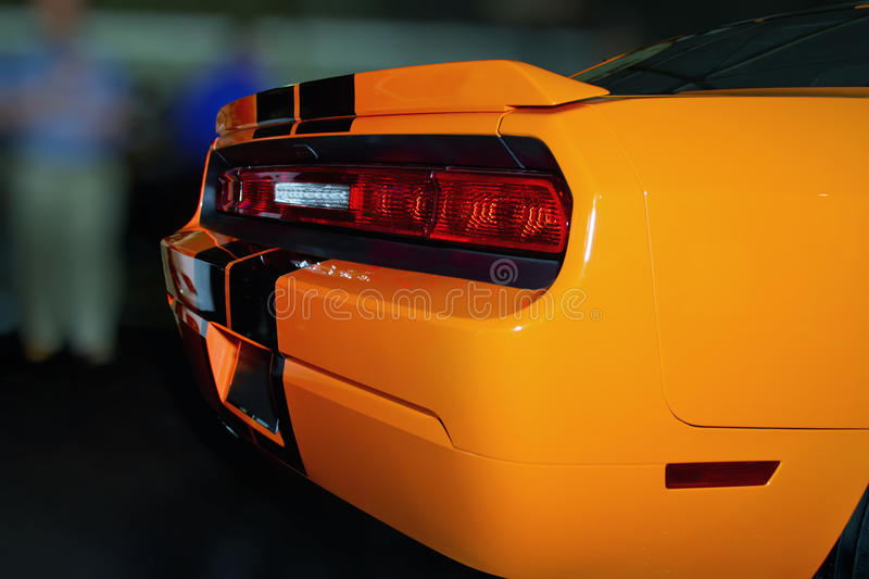 Bright Orange New American Sports Car. Very bright orange colored new expensive American luxury sports car sometimes called a muscle car because of it high stock images