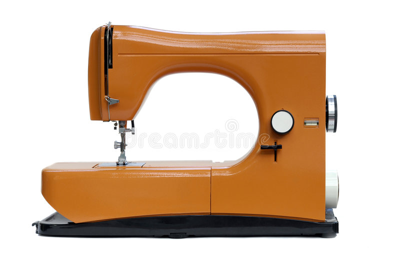 Bright orange sewing machine. A bright orange italian eighties sewing machine isolated on white royalty free stock photography