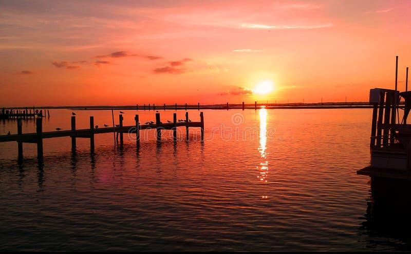 Bright orange sunset reflecting on the sea stock image