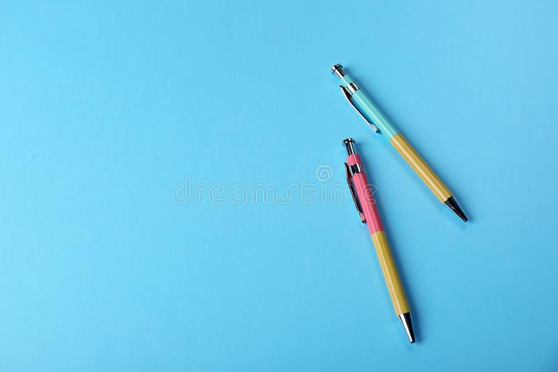 Bright pens on color background, flat lay. Space for text royalty free stock image