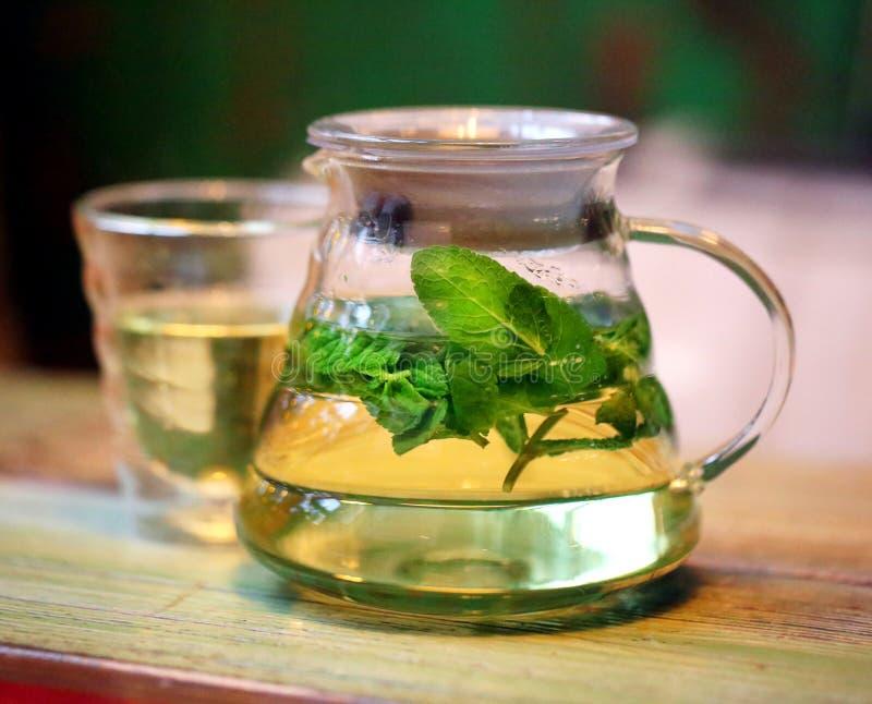 Bright photo background macro big tea mint in a teapot stock photos