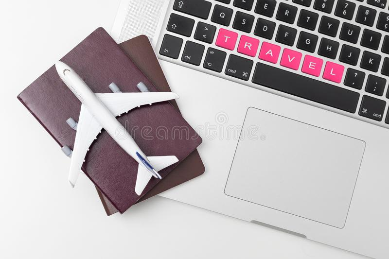 Passport , white plane model and computer laptop on white background . travel , visa and vacation concept stock images