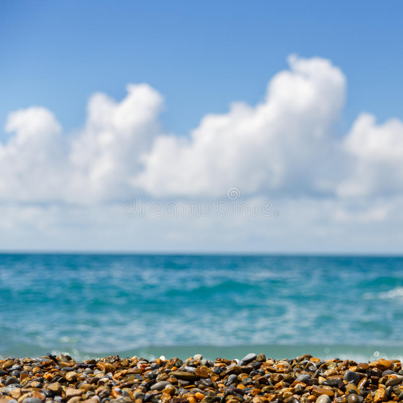 Bright picture of seashore with blue sky and sea stock images