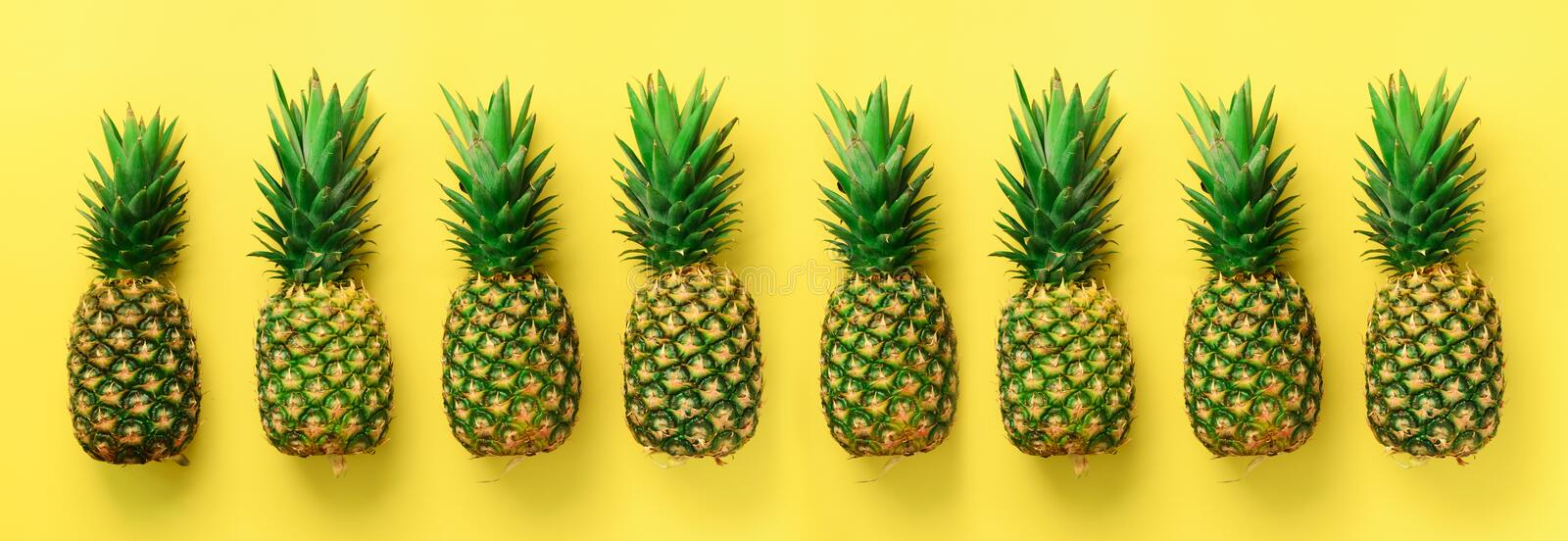 Bright pineapple pattern for minimal style. Top View. Pop art design, creative concept. Copy Space. Banner. Fresh stock image