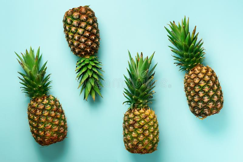 Bright pineapple pattern for minimal style. Top View. Pop art design, creative concept. Copy Space. Banner. Fresh. Pineapples on blue background royalty free stock image